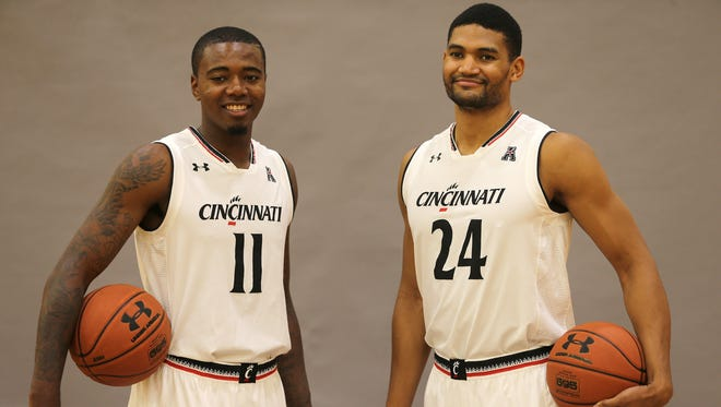 Kyle Washington (24) and fellow University of Cincinnati senior forward Gary Clark pose before a recent practice. UC coach Mick Cronin said that 'rim expert' Washington will find the baskets the same height at temporary UC home NKU as anywhere else.