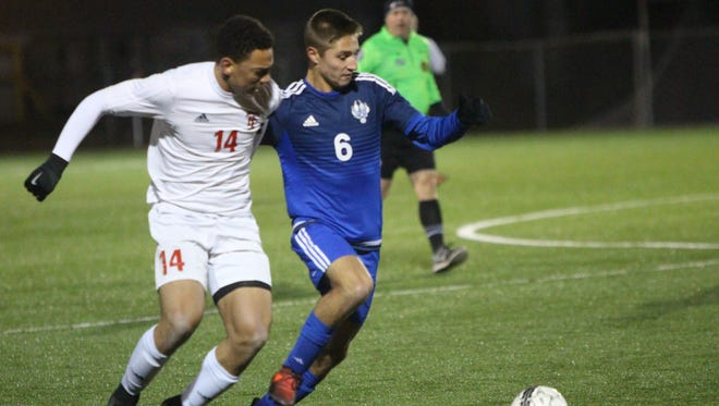 Wauwatosa East's Jalen Holley (left) tangles with Waukesha West's Tucker Remmers in the WIAA Division 2 soccer sectional final Oct. 28 in Wauwatosa.