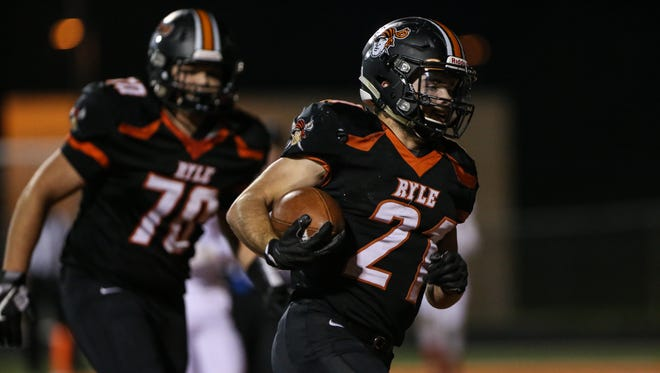 Jacob Chisholm scores Ryle's first touchdown during their first-round playoff game with Butler at Ryle, Friday, November 3, 2017.