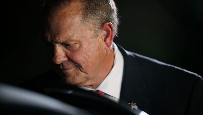 Former Alabama Chief Justice and U.S. Senate candidate Roy Moore leaves after he speaks at a church revival, Tuesday, Nov. 14, 2017, in Jackson, Ala.