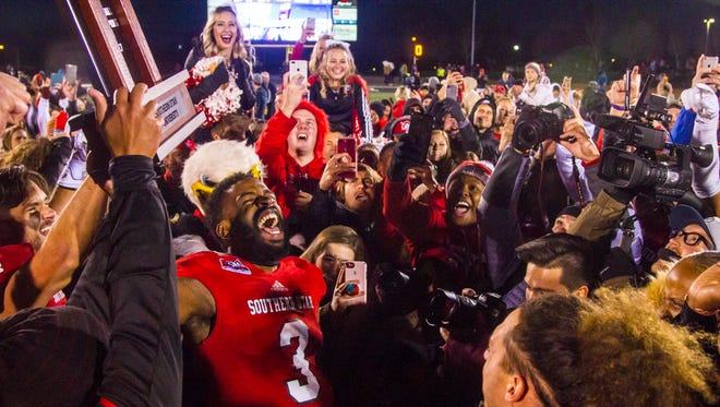 Southern Utah celebrates winning the Big Sky title after defeating Northern Arizona 48-20 on Saturday, November 18, 2017, in Cedar City, Utah.