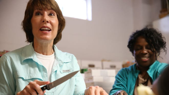 Gubernatorial candidate Gwen Graham (left) and long-time Project Annie volunteer Melissa Hannah chop onions for Thanksgiving dinner at Project Annie's Fourth Avenue kitchen Tuesday.