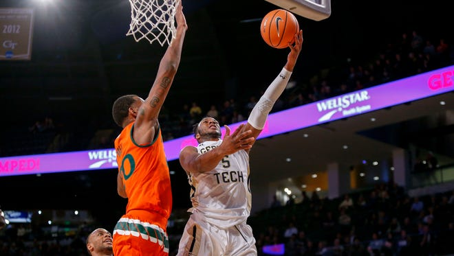 Josh Okogie (5) shoots the ball against Miami in the first half at McCamish Pavilion.