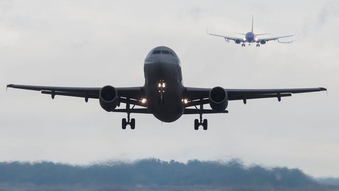 Airplanes take off and land at Ronald Reagan Washington National Airport on Aug. 7, 2017.