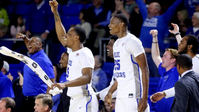 MTSU players, from left, Nick King (5) and Karl Gamble celebrate from the bench after teammate Chase Miller scores his first college basket during the game against Rice on Thursday.