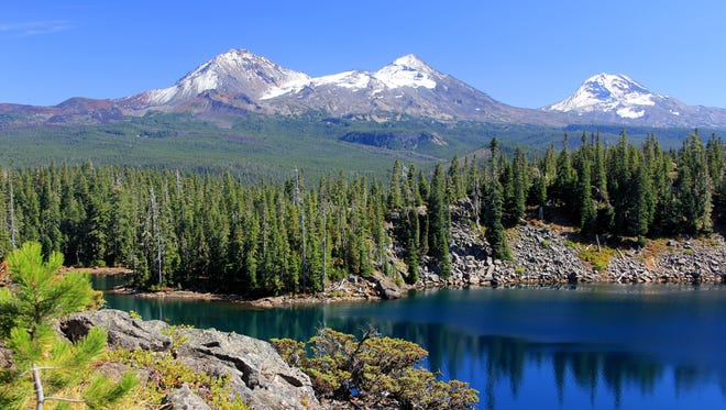The view of the Three Sisters above Benson Lake, in the Mount Washington Wilderness, is memorable.