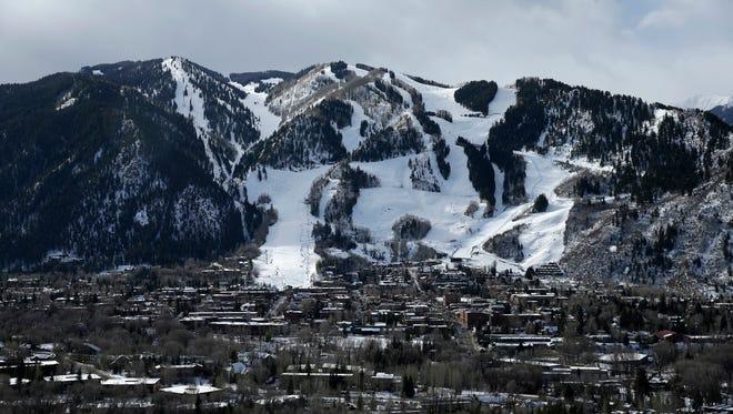 This Dec. 1, 2014 file photo shows Aspen Mountain ski area by Aspen, Colo.