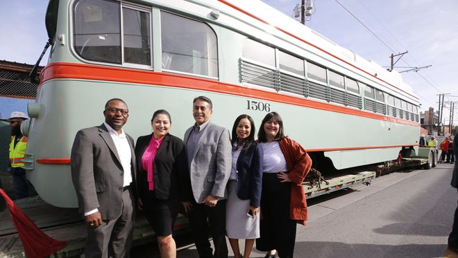 Members of El Paso City Council stand in front of the streetcar as it returns to El Paso.