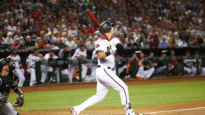 Arizona Diamondbacks Jake Lamb hits a 2-run double against the Colorado Rockies in the 1st inning on Mar. 29, 2018 during the season opener at Chase Field in Phoenix, Ariz.