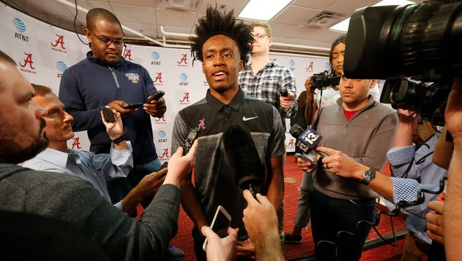 University of Alabama freshman NCAA college basketball guard Collin Sexton announces his intention to enter the NBA Draft during a press conference in Tuscaloosa, Ala., Friday, April 6, 2018. (Gary Cosby Jr./The Tuscaloosa News via AP)