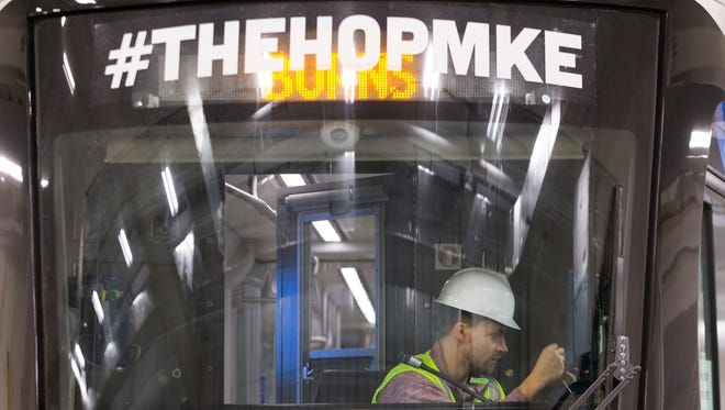 A Brookville Corp. employee works on The Hop, the first of the new city streetcars at the Streetcar Operations and Maintenance Facility at 450 N. 5th St. in Milwaukee. The vehicle arrived in Milwaukee by flatbed truck from Pennsylvania on March 26. Service for the initial downtown route is scheduled to begin in fall 2018, and the lakefront line is expected to start operating in 2019. The 2.5-mile streetcar route will connect the Milwaukee Intermodal Station with the city's lower east side.