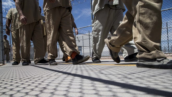 Detainees head out for lunch from one of the housing units at the Eloy Detention Center facility.