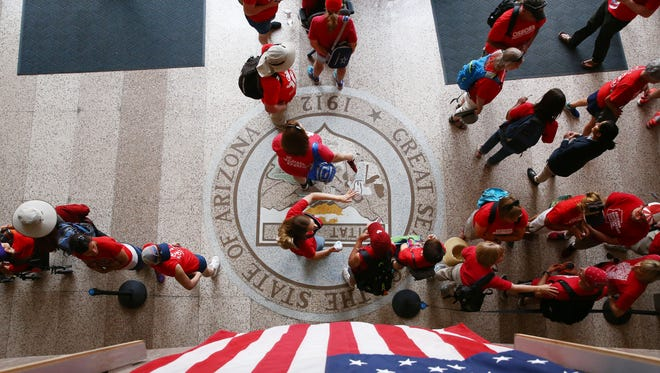 Arizona teachers gather in the lobby of the Senate building at the Arizona State Capitol during Day 3 of a walkout for higher pay and more education funding on April 30, 2018, in Phoenix, Ariz.