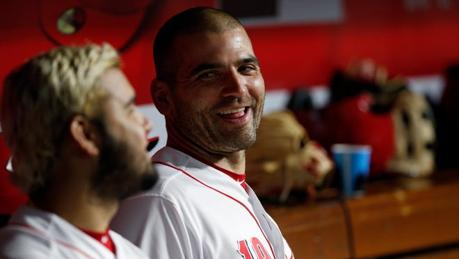 Cincinnati Reds first baseman Joey Votto (19) laughs with third baseman Eugenio Suarez (7) in the dugout during the sixth inning of the MLB National League game between the Cincinnati Reds and the Miami Marlins at Great American Ball Park in downtown Cincinnati on Friday, May 4, 2018. Raisel Iglesias tallies a save as the Reds win 4-1.