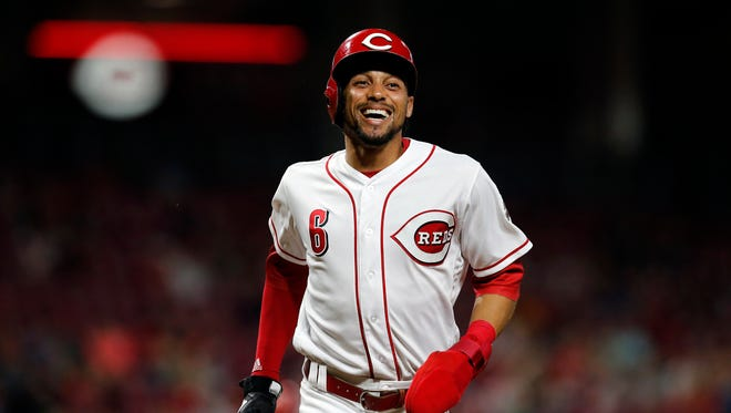 Cincinnati Reds center fielder Billy Hamilton (6) laughs as he returns to the dugout after the bottom of the eighth inning of the MLB National League game between the Cincinnati Reds and the Miami Marlins at Great American Ball Park in downtown Cincinnati on Friday, May 4, 2018. Raisel Iglesias tallies a save as the Reds win 4-1.