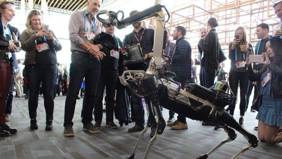 A Boston Dynamics Spot robot mingles with the crowd