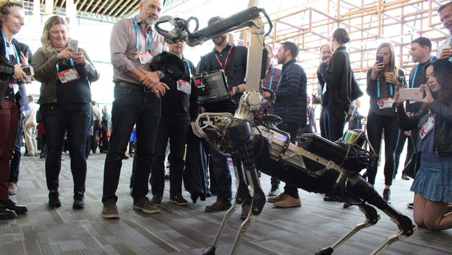 A Boston Dynamics Spot robot mingles with the crowd at the TED Conference in Vancouver last year.