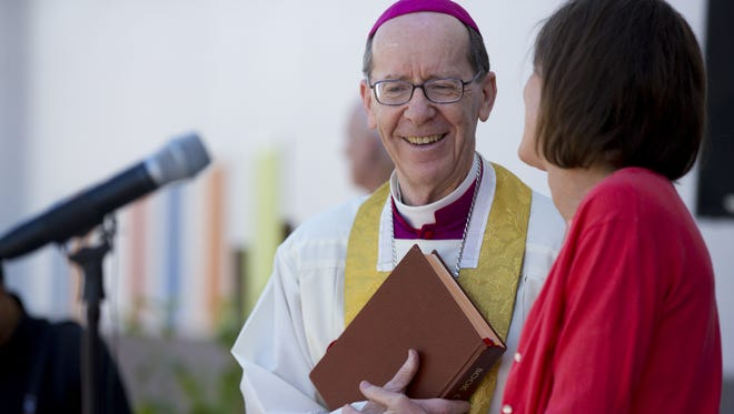 Bishop Thomas Olmsted prepares to bless St. Vincent de Paul's new building on its main downtown campus in Phoenix on May 18, 2018.The building houses a new family resource center and an expanded shelter for the elderly, disabled, and homeless.