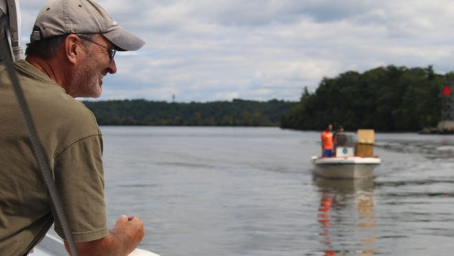 John Lipscomb, the patrol boat captain and vice president for advocacy at Riverkeeper, on the Hudson River north of Kingston.