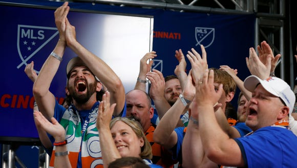 FC Cincinnati supporters cheer at the announcement