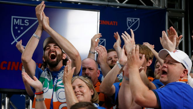 FC Cincinnati supporters cheer at the announcement of the team's acceptance to Major League Soccer at Rhinegeist Brewery in the Over-the-Rhine neighborhood of Cincinnati on Tuesday, May 29, 2018. FC Cincinnati was announced as the newest expansion team to join Major League Soccer.