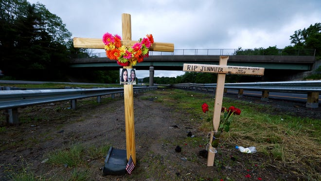 A roadside memorial for Miranda Vargas, 10, and Jennifer Williamson-Kennedy on the median of Route 80 in Mount Olive.