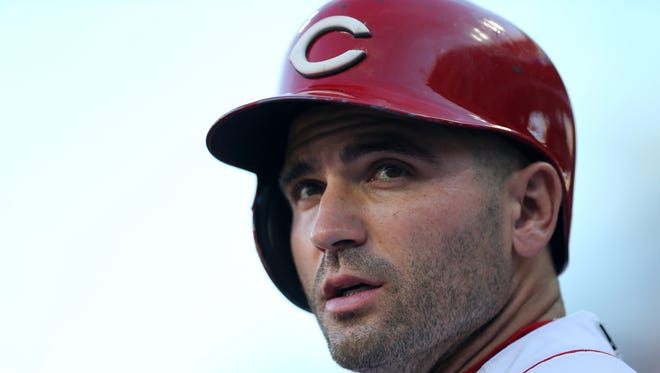 Cincinnati Reds first baseman Joey Votto (19) stands on the the dugout steps in the first inning during a National League baseball between the Milwaukee Brewers and the Cincinnati Reds, Friday, June 29, 2018, at Great American Ball Park in Cincinnati.