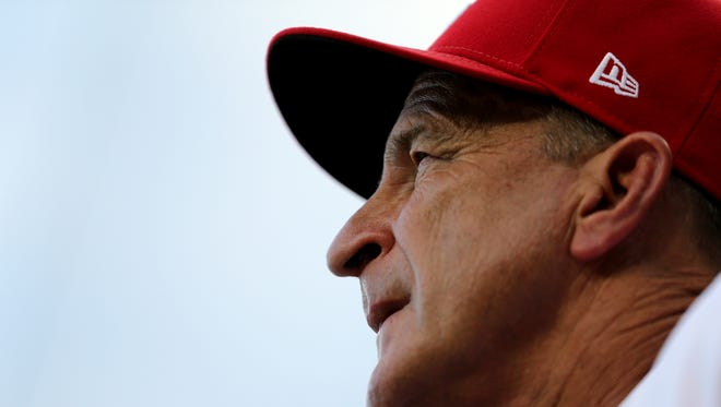 Cincinnati Reds interim manager Jim Riggleman (35) watches the game in the third inning during a National League baseball between the St. Louis Cardinals and the Cincinnati Reds, Monday, July 23, 2018, at Great American Ball Park in Cincinnati.