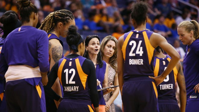 Phoenix Mercury head coach Sandy Brondello huddles with her players against Chicago Sky in the second half on July 25, 2018 at Talking Stick Resort Arena in Phoenix, Ariz.