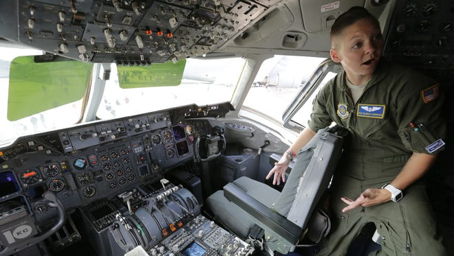 Tech. Sgt. Blakeley Murdock, flight engineer, talks about her experience in the cockpit of a McDonnell Douglas KC-10 Extender, Friday, July 27, 2018, at EAA AirVenture 2018 in Oshkosh.