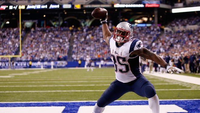 Jonas Gray of the New England Patriots celebrates scoring his fourth touchdown against the Indianapolis Colts during the fourth quarter of the game at Lucas Oil Stadium on November 16, 2014 in Indianapolis, Indiana.