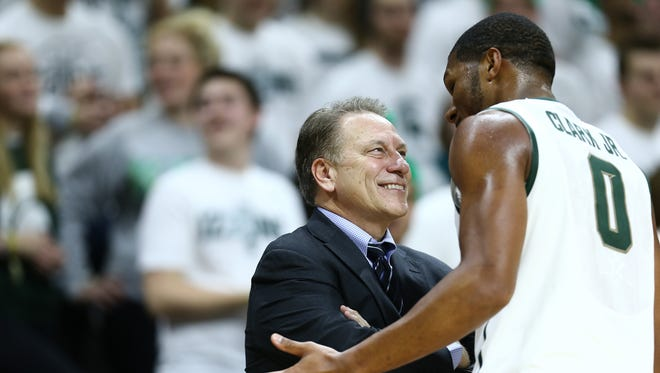 Head coach Tom Izzo of the Michigan State Spartans talks to Marvin Clark Jr. #0 of the Michigan State Spartans during a timeout against the Loyola-Chicago Ramblers at the Breslin Center on November 21, 2014 in East Lansing, Michigan. Michigan State defeated Loyola-Chicago 87 - 52.