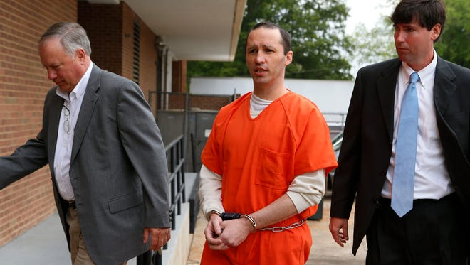 James Everett Dutschke, center, is led into the Federal Building in Aberdeen by U.S. Marshals for a sentencing hearing.