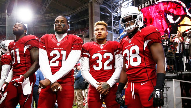 Antonio Cromartie (31), Patrick Peterson (21) and Tyrann Mathieu (32) are three of the major players in the Cardinals' hugely successful defensive backfield this season.