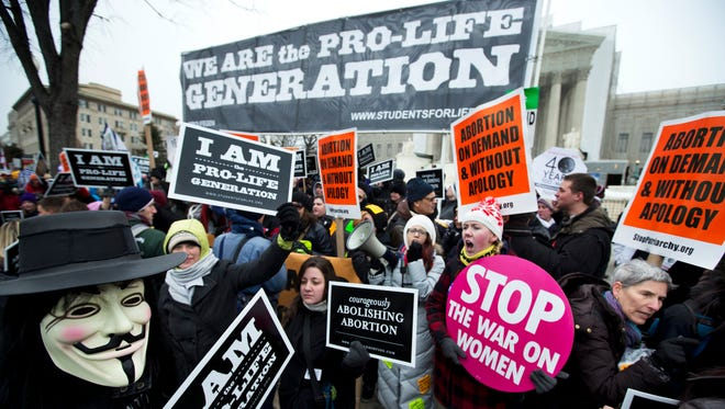 Pro-abortion rights activists, rally face-to-face against anti-abortion demonstrators.