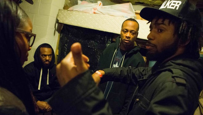 """Twenty-five-year-old independent underground filmmaker Kenneth Walker (right), directs actors Stephanie Williams (from left), 30, of Dover, Richard """"Rich Boy"""" Thompson, 23, of Dover and Anthony """"Boney Manayna"""" Daniels, 28, of Dover during a filming of his latest video episodes of the """"Delaware Bodycount"""" series on YouTube."""