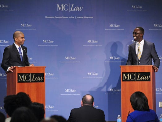 Jackson mayoral candidates Chokwe Antar Lumumba, left, and Tony Yarber, share a laugh during one of the lighter moments of Wednesday night's debate at the Mississippi College School of Law.