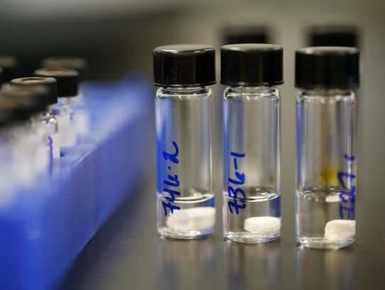 Various drug types sit in tubes for analysis at the