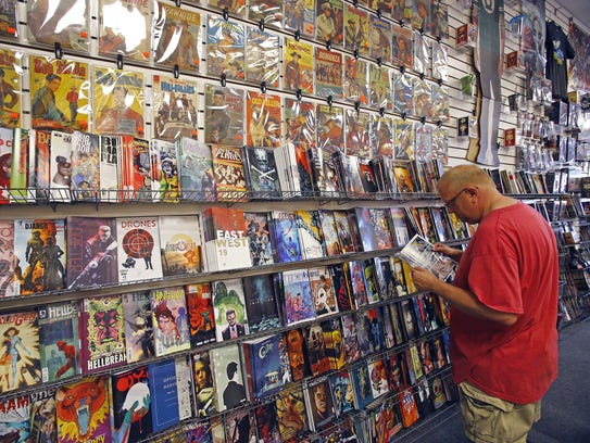 John Hancock checks out the comic-book selection on