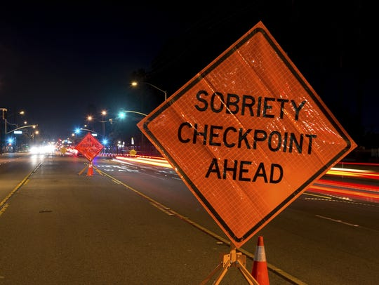 In this stock photo, a sobriety checkpoint is pictured.