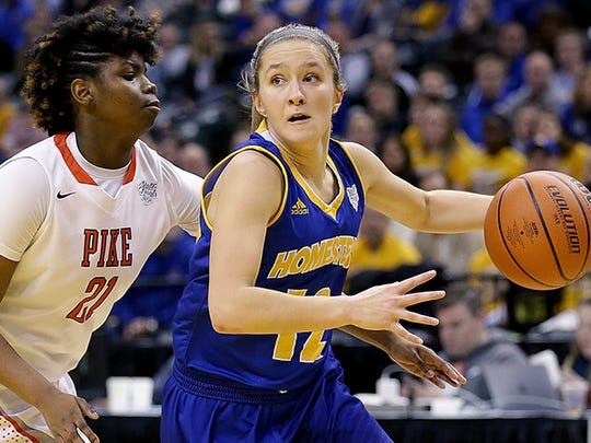 Homestead Spartans Karissa McLaughlin (12) drives around Pike Red Devils Michaela White (21) in the second half of their IHSAA 4A Girls Basketball State Finals game Saturday, February 25, 2017, evening at Bankers Life Fieldhouse. The Homestead Spartans defeated the Pike Red Devils  61-54.