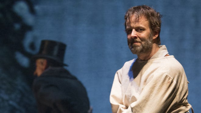 """Noah Racey is one of three asylum inmates claiming to be Sherlock Holmes in Arizona Theatre Company's world-premiere mystery """"Holmes and Watson."""""""