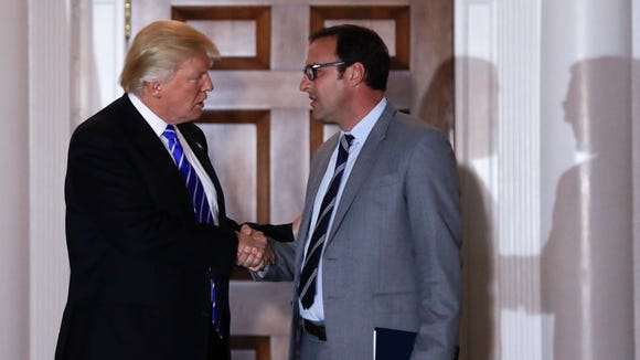 President-elect Donald Trump and Todd Ricketts, a co-owner of the Chicago Cubs, shake hands as Ricketts leaves the Trump National Golf Club Bedminster clubhouse in Bedminster, N.J., on Nov. 19, 2016.