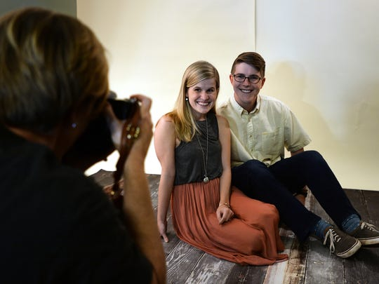 Photographer Maribeth Fields makes a photograph of Perrin Hall and her husband Joe for Flashes of Hope, a non-profit  organization that creates portraits of children and young adults with cancer.