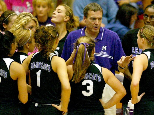 In this 2003 file photo, Muncie Central volleyball coach Wes Lyon talks to his team between periods at the IHSAA Volleyball Regional in the Muncie Fieldhouse.