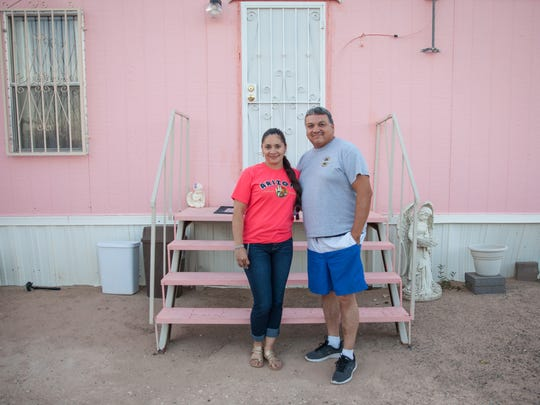 Cristina Morales and her husband, Rafael Martinez, said they don't plan on moving from Horizon View Estates, a colonia in El Paso County, Texas. The colonia has no sewage treatment, and they said the tap water occasionally comes out brown.