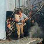 "Owen Wilson, right, and Lake Bell appear in a scene from, ""No Escape."""