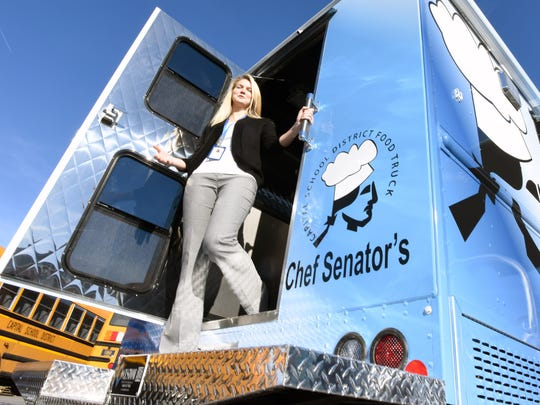 Brittany Adams, nutritionist for the Capital School District, in Dover with the new food truck for The Capital School District. The truck will be unveiled Monday, MLK day, and utilized in the community to provide free meals for the summer food program.