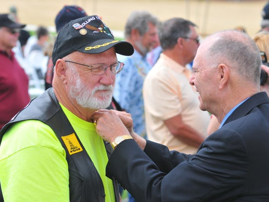 Congressman Bill Posey pins Jesse Gregory with his