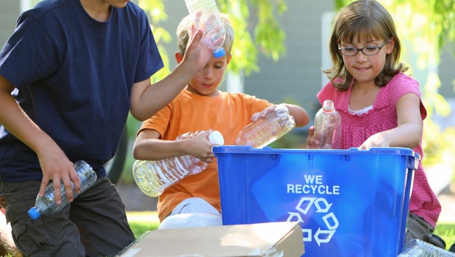 Kids and recycling bin